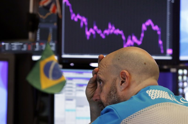 Specialist Meric Greenbaum works at his post on the floor of the New York Stock Exchange, Tuesday, Feb. 25, 2020. (AP Photo)