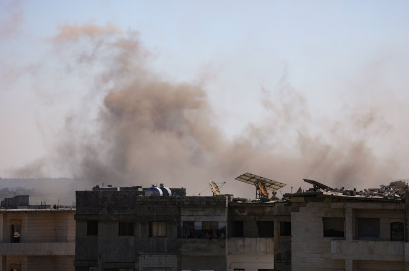 Smoke billows above the rebel-controlled town of Binnish near the regime-controlled town of Saraqeb, east of the Idlib province in northwestern Syria, Feb. 26, 2020, during airstrikes carried out by pro-regime forces. (AFP Photo)