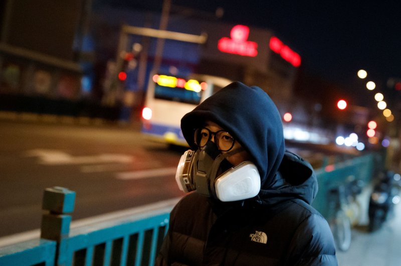 A man wears a full face mask in a street in Beijing as the country is hit by an outbreak of the novel coronavirus, China, February 26, 2020. (Reuters Photo)