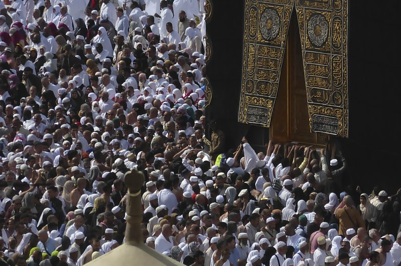 Muslim pilgrims circumambulate the Kaaba, the cubic building toward which Muslim believers turn when praying, at the Grand Mosque, during the minor pilgrimage, known as Umrah, in the Muslim holy city of Mecca, Saudi Arabia, Monday, Feb. 24, 2020. (AP Photo)