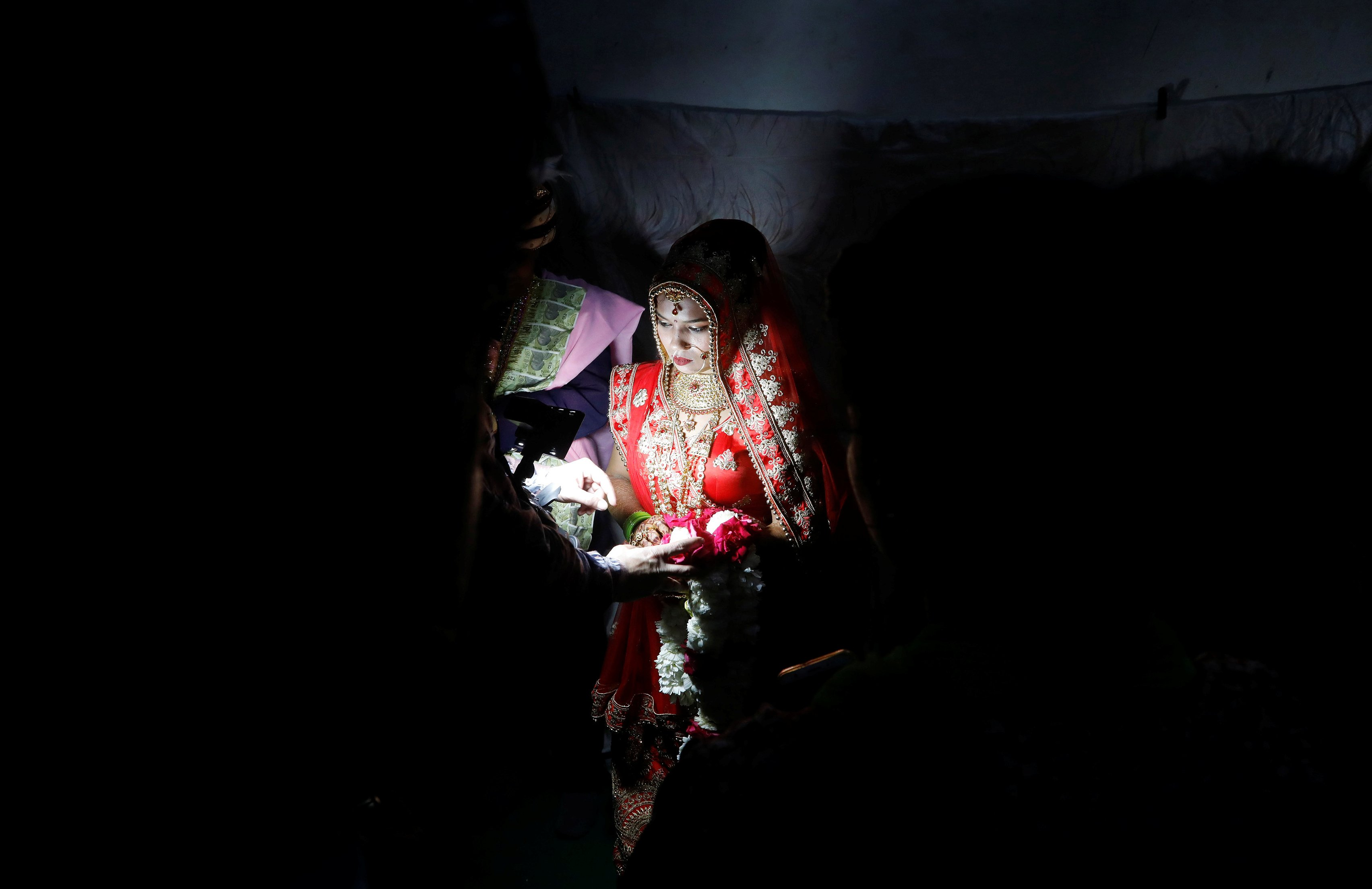 Prasad takes her wedding vows inside her parents' house. (Reuters Photo)
