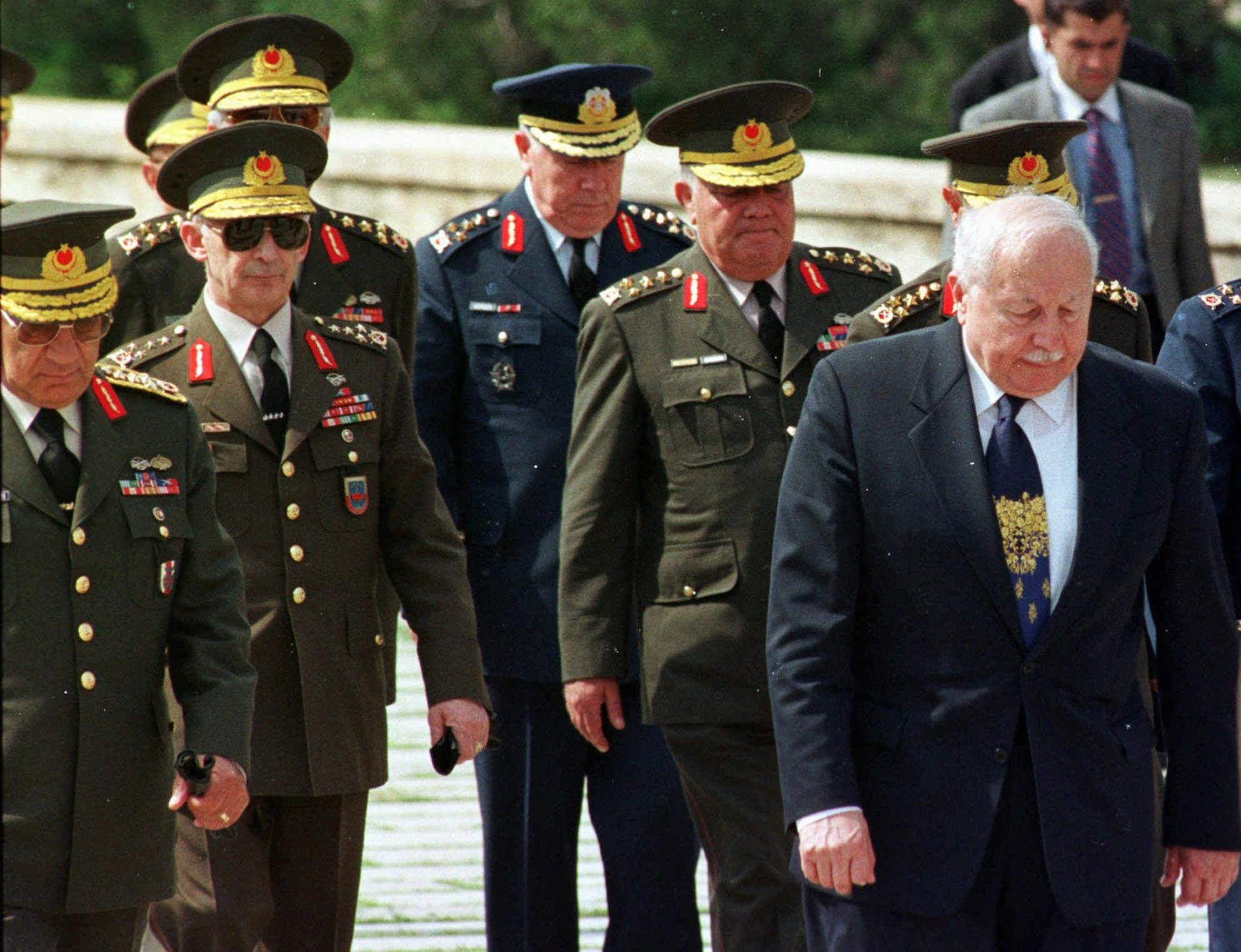 Turkish Prime Minister Necmettin Erbakan, (R), and the country's top generals watch their steps as they walk together to the mausoleum of Mustafa Kemal Atatürk, founder of Turkish Republic, May 26, 1997. (AP Photo)