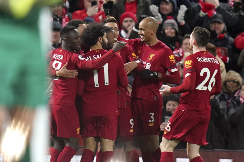 Liverpool players celebrate a first goal during an EPL match against, Feb. 24, 2020. (AP Photo)
