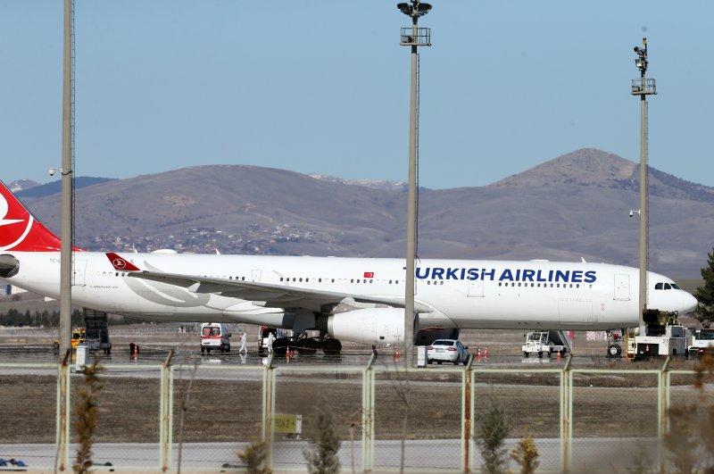 Ambulances are seen near a Turkish Airlines (THY) plane from Tehran after landing at Esenboğa International Airport, Ankara, Feb. 25, 2020. (Reuters Photo)