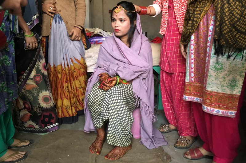 Savitri Prasad, a 23-year-old bride, sits in her parents' home before taking her wedding vows in a riot-affected area following clashes between people demonstrating for and against a new citizenship law in New Delhi, India, Feb. 26, 2020. (Reuters Photo)