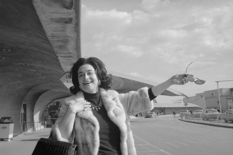 Leyla Gencer basks in the New York sunshine outside Trans-World Airlines terminal building at JFK Airport on Apr. 11, 1973, shortly after her arrival from Milan. (AP Photo)