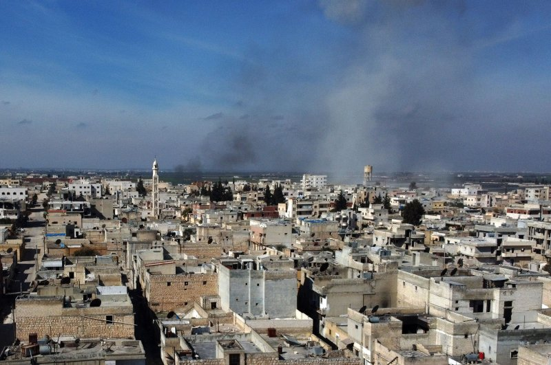 Smoke billows over the town of Saraqib in the eastern part of the Idlib province in northwestern Syria, following bombardment by Assad regime forces, on Feb. 27, 2020. (AFP Photo)