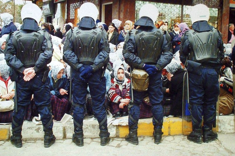 Students stage a protest against the headscarf ban in front of a jewelry shop, across from the Kadıköy İmam Hatip High School, Istanbul, Feb. 21, 2002.