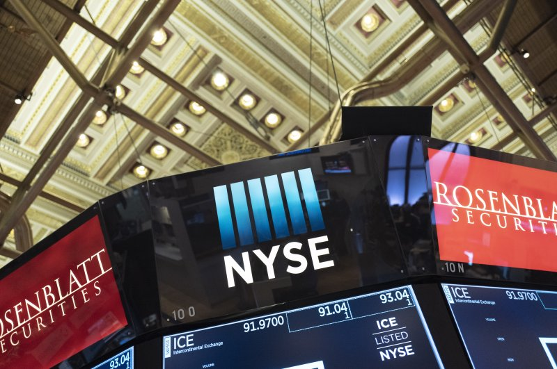 Electronic screens are displayed at the New York Stock Exchange, Wednesday, Feb. 26, 2020. (AP Photo)