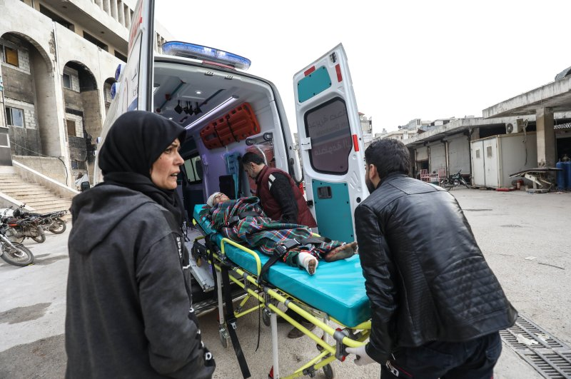 A child is taken into an ambulance after an Assad regime bombardment (AA Photo)