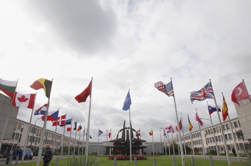 Flags of the NATO allies wave in the wind outside NATO headquarters in Brussels on Wednesday, Oct. 5, 2011. (AP Photo)