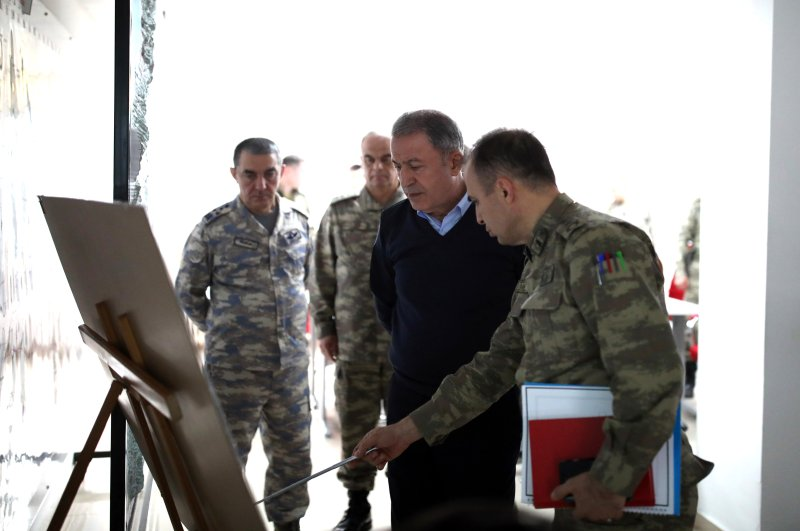 Defense Minister Hulusi Akar at the border with military personnel after the Assad regime's attack on Turkish soldiers, Feb. 27, 2020. (AA Photo)