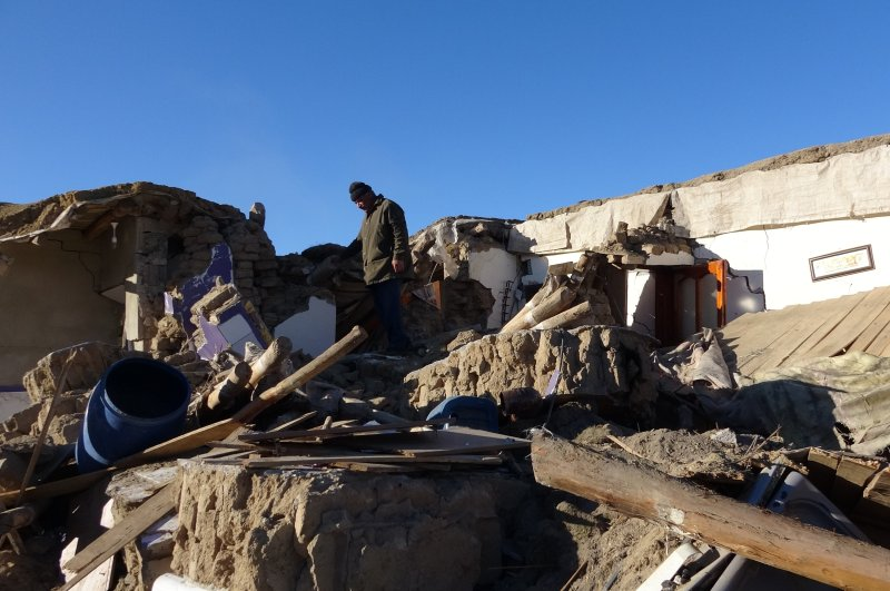 A man looks at the debris of a house collapsed in Feb. 23 earthquake in Van, eastern Turkey, Feb. 28, 2020. (İHA Photo)