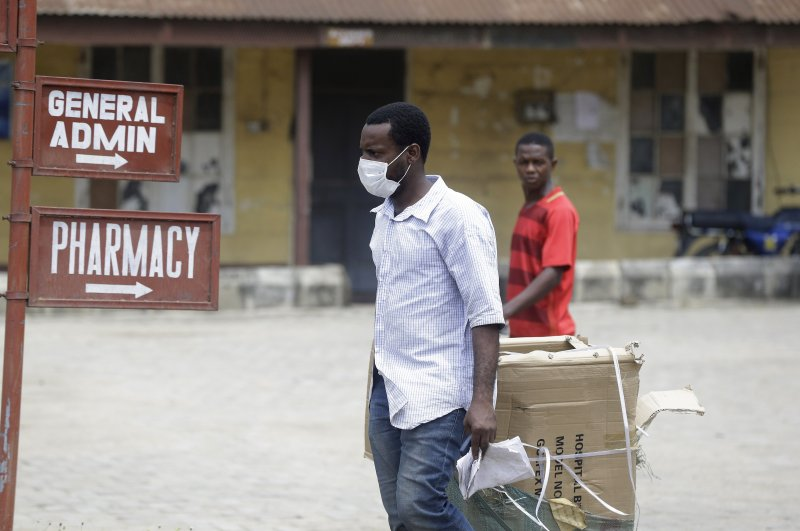 A man wearing a face mask walks at the Mainland Hospital Yaba, where the first Nigerian victims are being treated, Lagos, Feb. 28, 2020. (AP Photo)