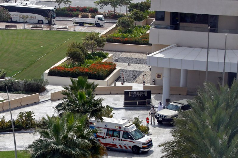 This picture taken on Feb. 28, 2020, shows an ambulance and an emergency medical response team on the scene at the Crowne Plaza hotel at Yas Island Abu Dhabi. (AFP Photo)