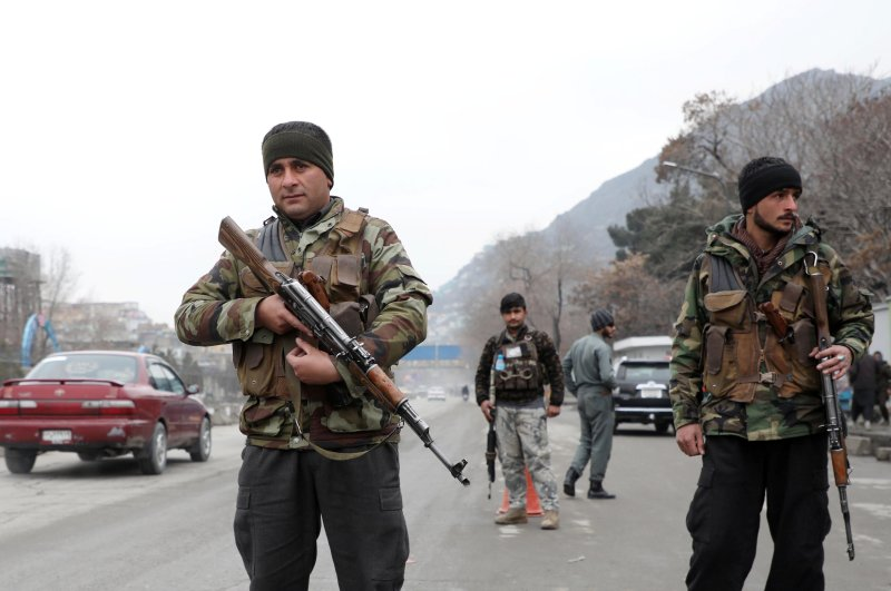 Afghan policemen keep watch at a checkpoint, Kabul, Feb. 28, 2020. (Reuters Photo)