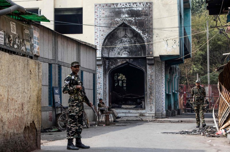 Security personnel stand guard outside a burnt-out mosque following anti-Muslim violence, Mustafabad area of New Delhi, Feb. 28, 2020. (AFP Photo)