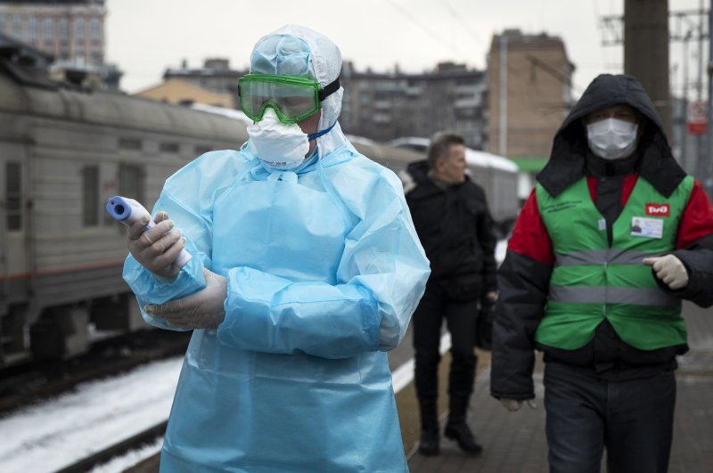 Medical workers prepare to check passengers arriving from Beijing at the Yaroslavsky railway station, Moscow, Jan. 31, 2020. (AP Photo)
