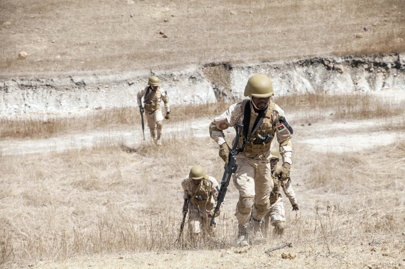 Burkina Faso paratroopers commando exercise under the supervision of Dutch special forces during U.S. military-led annual counterterrorism exercise in Thies, Senegal, Feb. 18, 2020. (AP Photo)