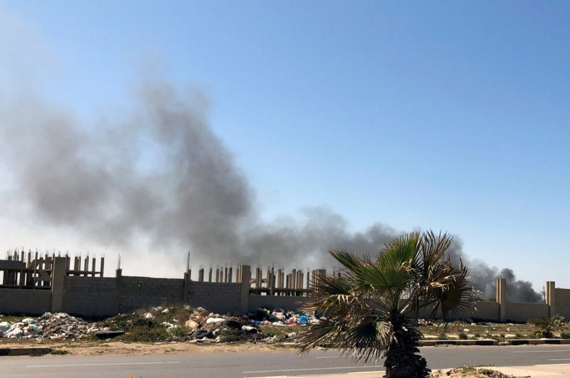 Smoke rises from Mitiga airport after an attack, in Tripoli, Libya, Feb. 28, 2020. (Reuters Photo)