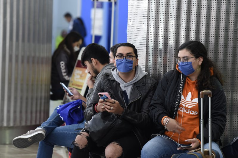 Passengers wearing protective masks are seen at the International Airport, Mexico City, Feb. 28, 2020. (AFP Photo)