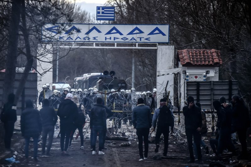 Greek police use tear gas against migrants waiting at the border crossing at Kastanies and Pazarkule to cross to the European Union territories on Feb. 28, 2020. (IHA Photo)