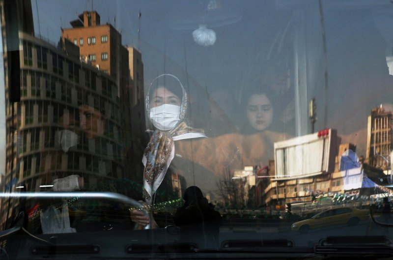 An Iranian woman wearing a protective mask to prevent contracting coronavirus stands in a bus in Tehran, Iran February 29, 2020. (Reuters via WANA)