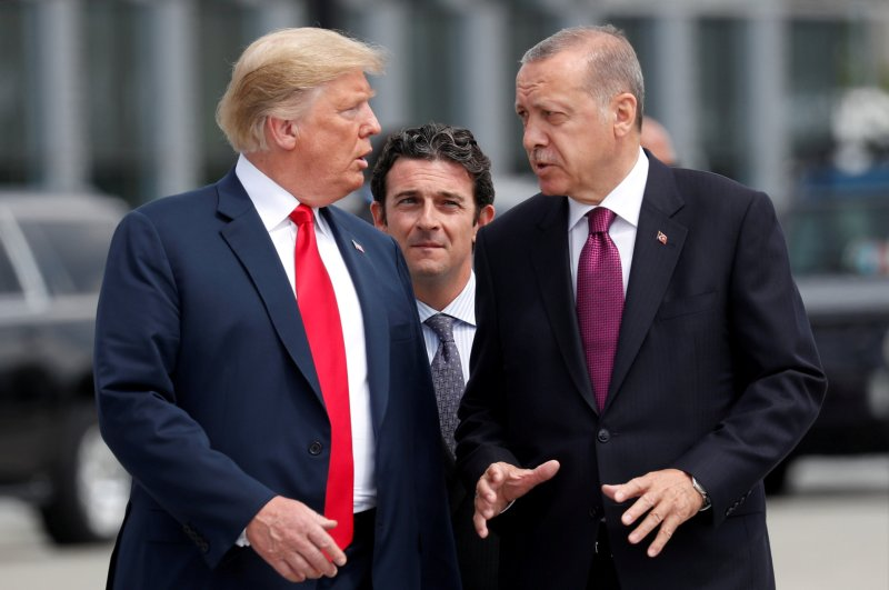 U.S. President Donald Trump and President Recep Tayyip Erdoğan gesture as they talk at the start of the NATO summit in Brussels, Belgium, July 11, 2018. (Reuters Photo)