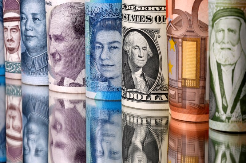 (From left to right) Saudi Riyal, Chinese Yuan, Turkish Lira, British Pound, U.S. Dollar, Euro and Jordanian Dinar banknotes are seen, Jan. 6, 2020. (Reuters Photo)