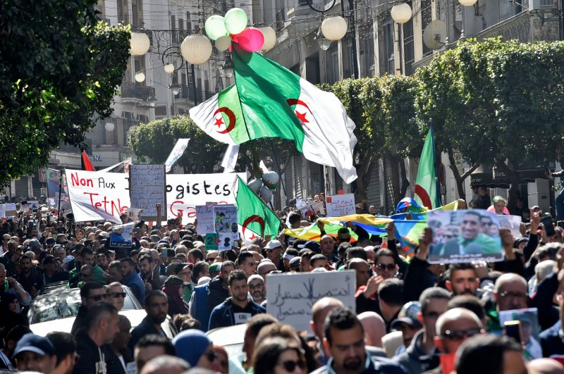 Algerian demonstrators wave the national flag during a demonstration in the capital Algiers, Feb.28, 2020. (AFP Photo)