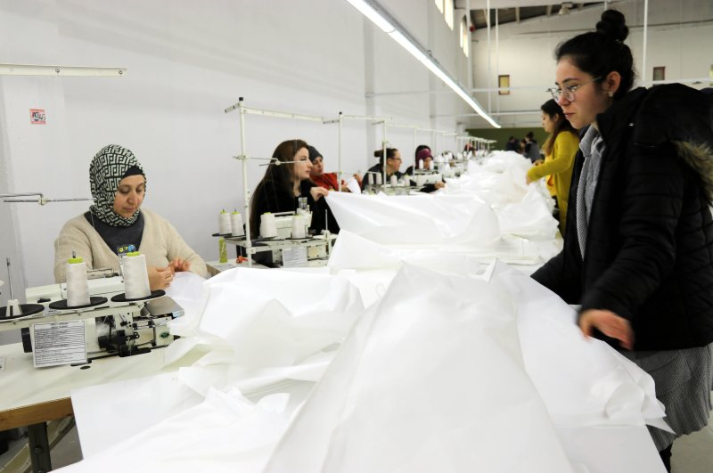 Workers are seen in the factory that has started producing antibacterial suits amid high demand from China, Amasya, Turkey, Feb. 29, 2020. (AA Photo)