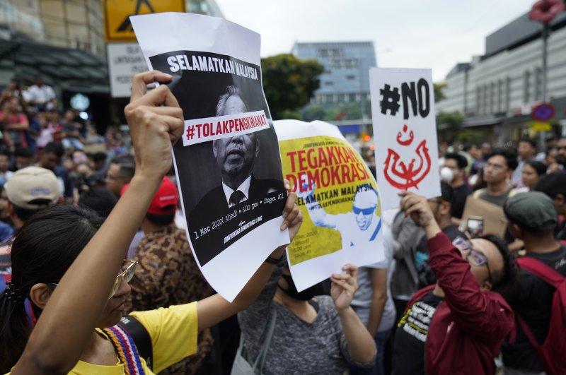 Demonstrators hold placards during a protest against Malaysia's newly sworn-in prime minister, Muhyiddin Yassin, Kuala Lumpur, March 1, 2020. (AP Photo)
