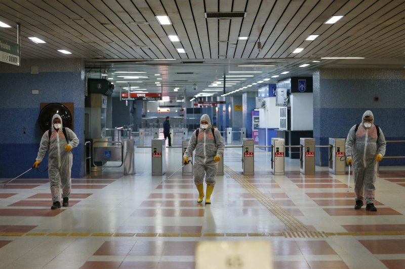 Workers disinfect a metro station against virus infections, Ankara, Feb. 26, 2020. (AA Photo)