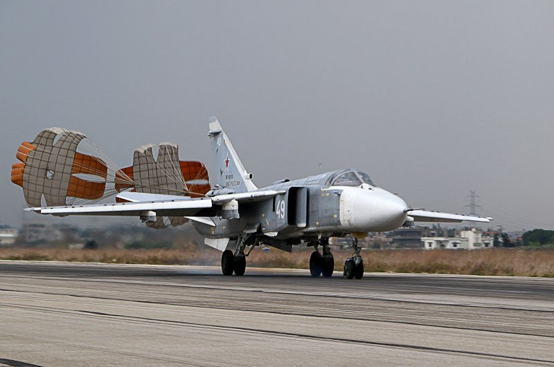 In this file photo taken on Dec. 16, 2015, a Russian Sukhoi Su-24 attack aircraft lands at the Russian Hemeimeem military base in Latakia province, in the northwest of Syria. (AFP Photo)