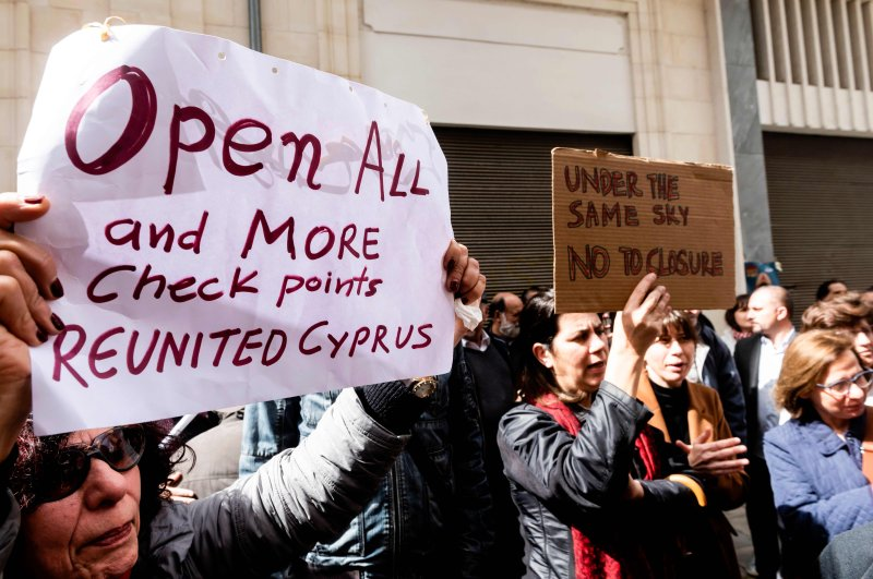 Cypriot demonstrators gather during a protest against the closure of checkpoints on Ledra Street in the divided capital of Nicosia on Nov. 29, 2020. (AFP Photo)