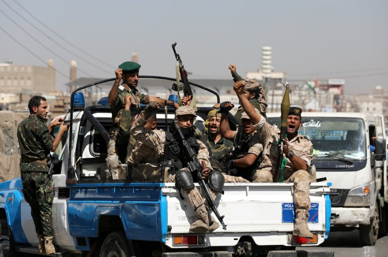 Houthi troops ride on the back of a police patrol truck after participating in a Houthi gathering in Sanaa, Yemen, Feb.19, 2020. (Reuters Photo)