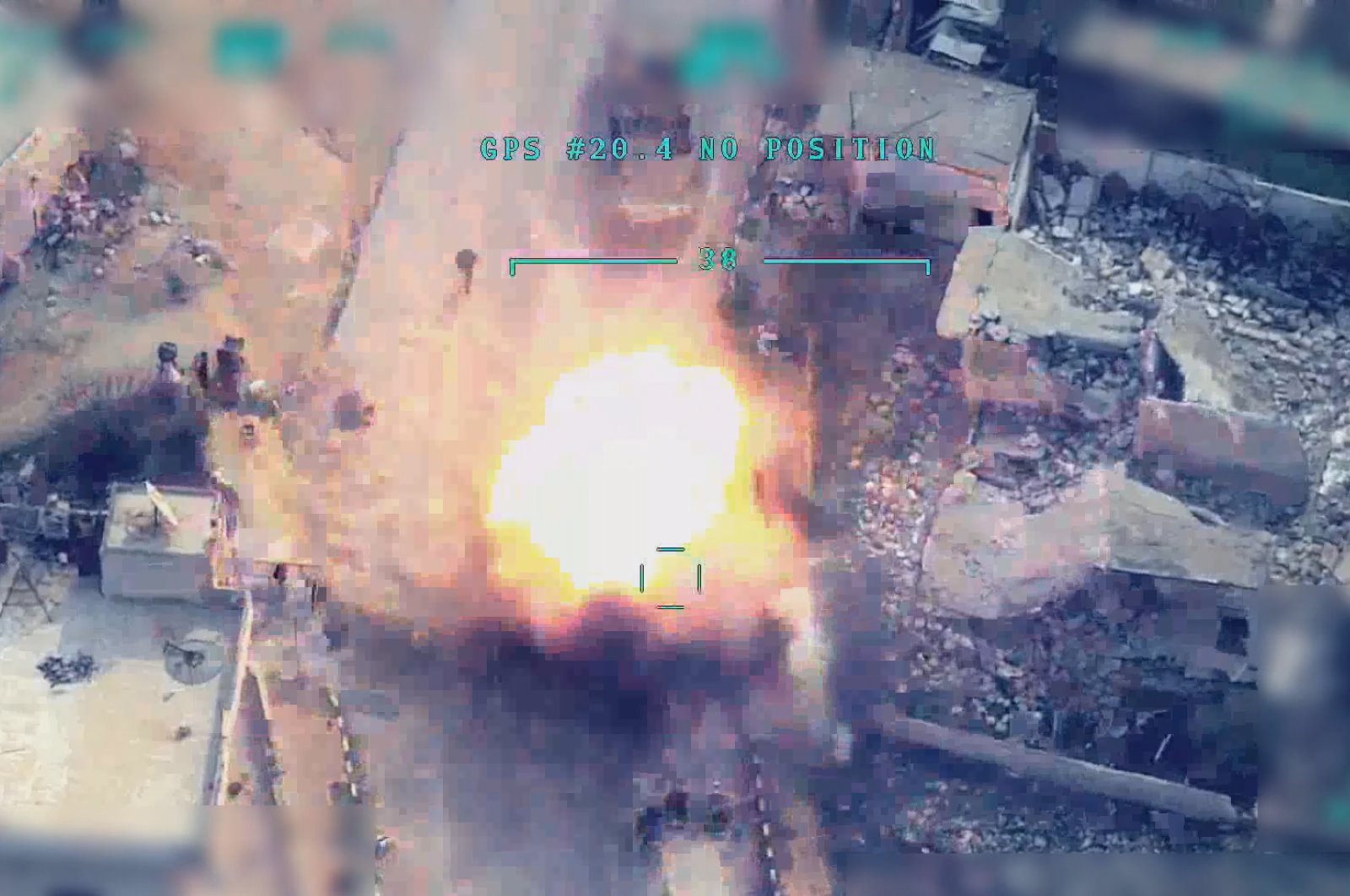 The footage shows a Turkish drone hitting Assad regime elements in the northern Syrian town of Idlib. (AA Photo)