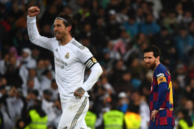 Lionel Messi (R) looks on as Real Madrid's Sergio Ramos celebrates his team's second goal in Madrid, March 1, 2020. (AFP Photo)
