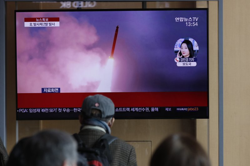 People watch a TV screen showing a news program reporting about North Korea's firing of projectiles with a file image at the Seoul Railway Station in Seoul, South Korea, Monday, March 2, 2020. (AP Photo)