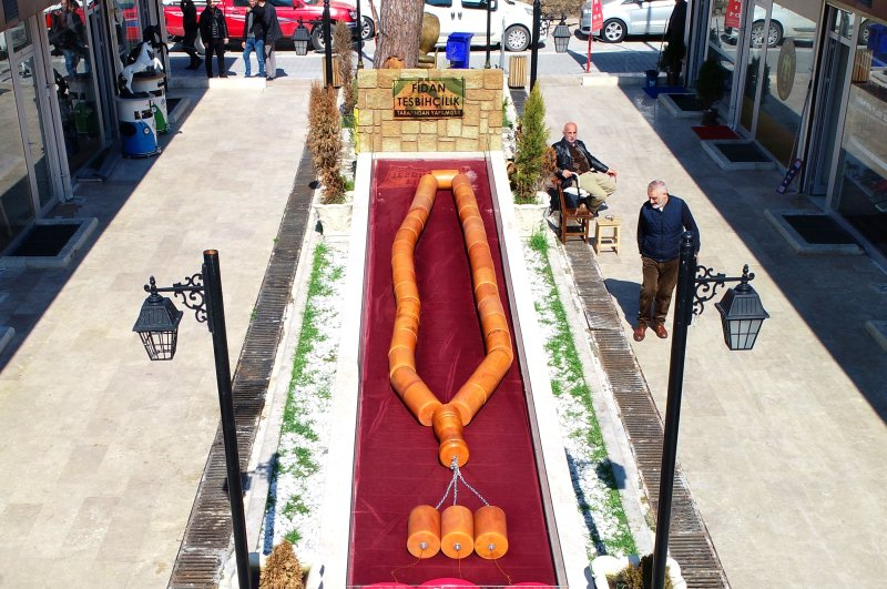 The huge prayer beads are currently on display at a marketplace, Adana, March 2, 2020. (İHA Photo)