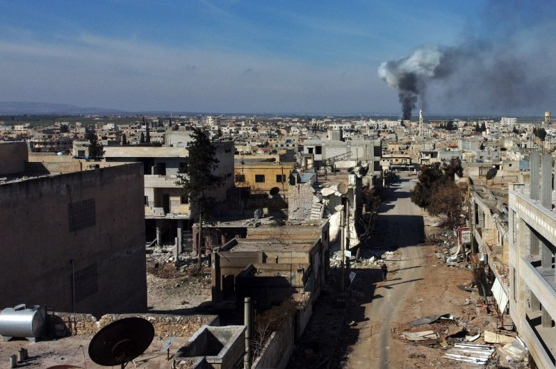 Smoke billows over the town of Saraqib in the eastern part of the Idlib province in northwestern Syria, following bombardment by Assad regime forces, Feb. 27, 2020. (AFP Photo)