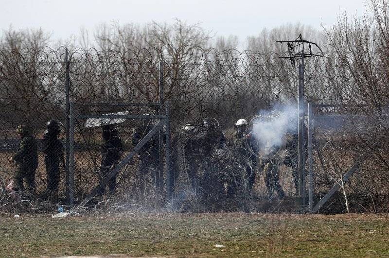 Greek police fires tear gas at migrants who trying to enter Greece during clashes at the Turkish-Greek border near the Pazarkule border gate in Edirne, March 2, 2020. (AP)