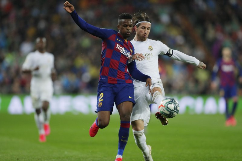 Barcelona's Semedo and Real Madrid's Ramos compete for the ball during the match in Madrid, March 1, 2020. (AP Photo)