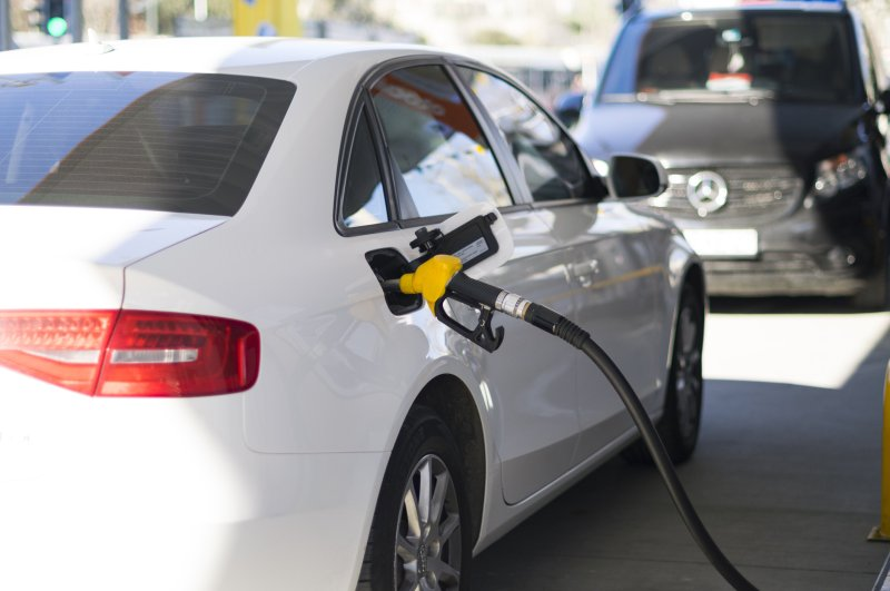 Pistol of a gas station is inserted into the tank of a car for a refuel, Istanbul, March 22, 2019. (Hasan Serhat Bozkurt / iStock Photo)