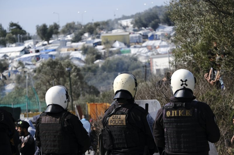 Greek riot police guard during clashes outside the Moria refugee camp on the northeastern Aegean island of Lesbos, Greece, March 2, 2020. (AP)