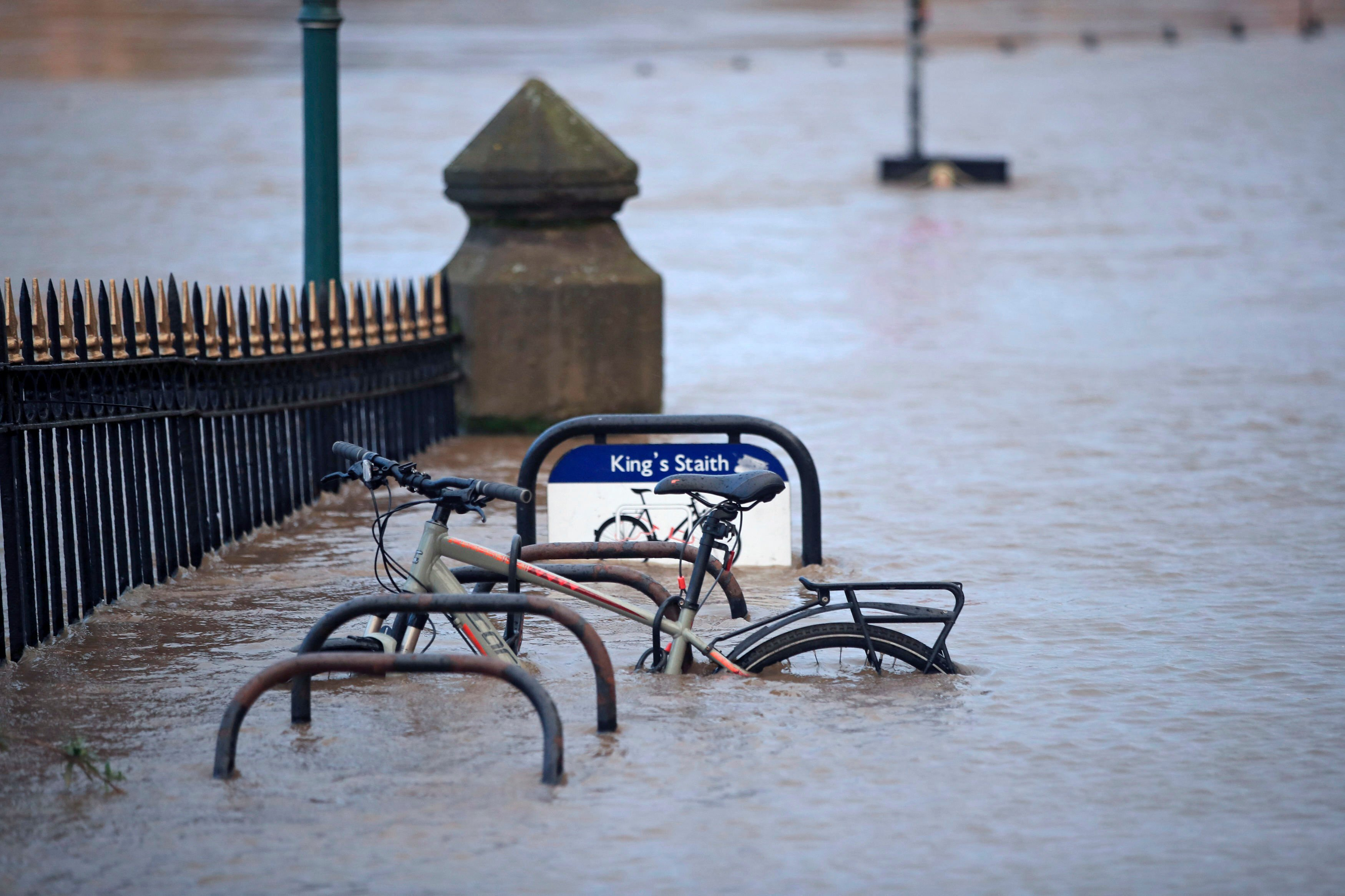 A cycle rack engulfed by floodwater after the River Ouse burst its banks in the aftermath of Storm Ciara, in York, England, Monday, Feb. 10, 2020. (AP Photo)