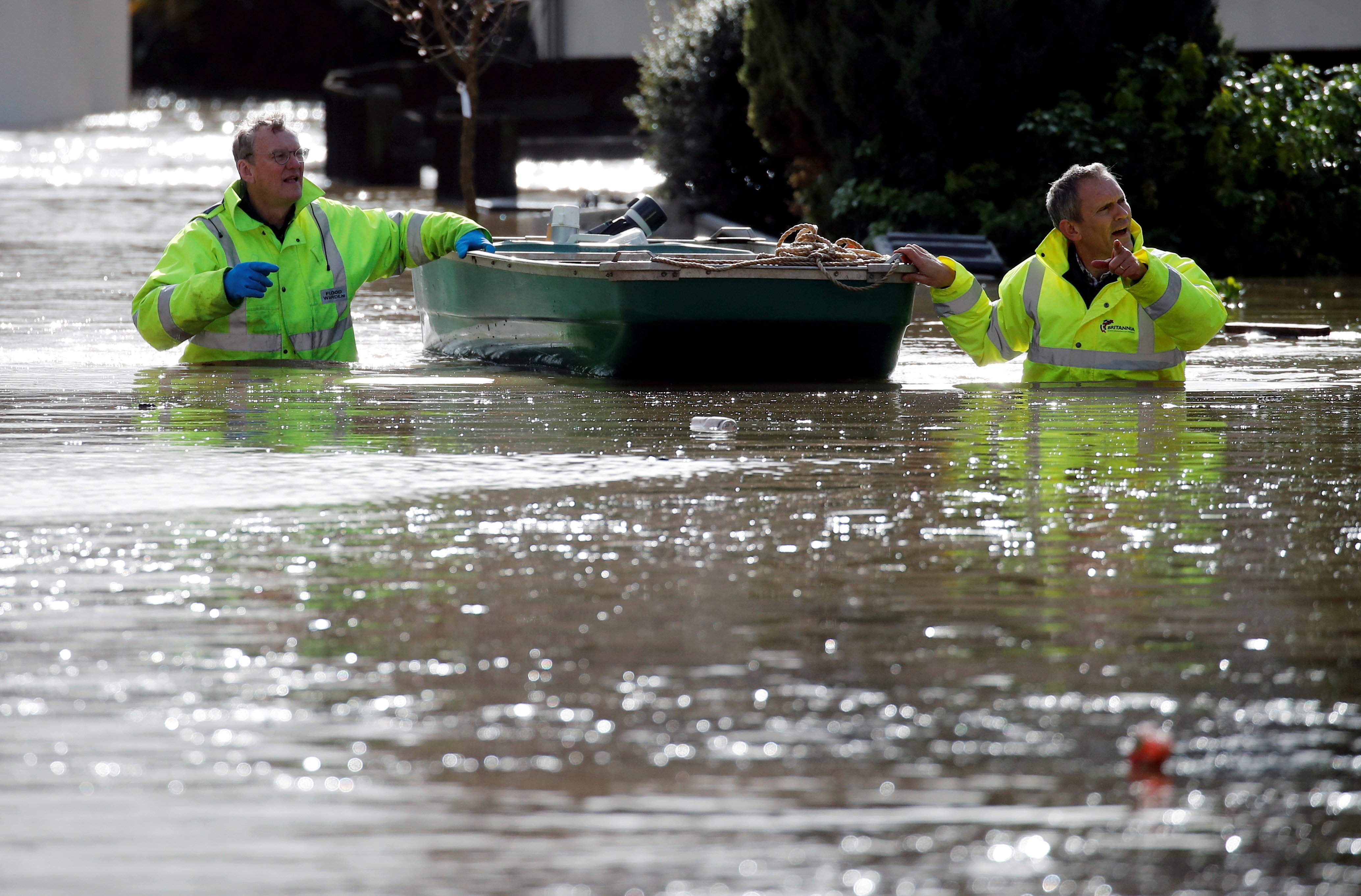 Emergency personnel wade through water in a flooded street after Storm Dennis in Hereford, Britain, February 17, 2020. (REUTERS Photo)