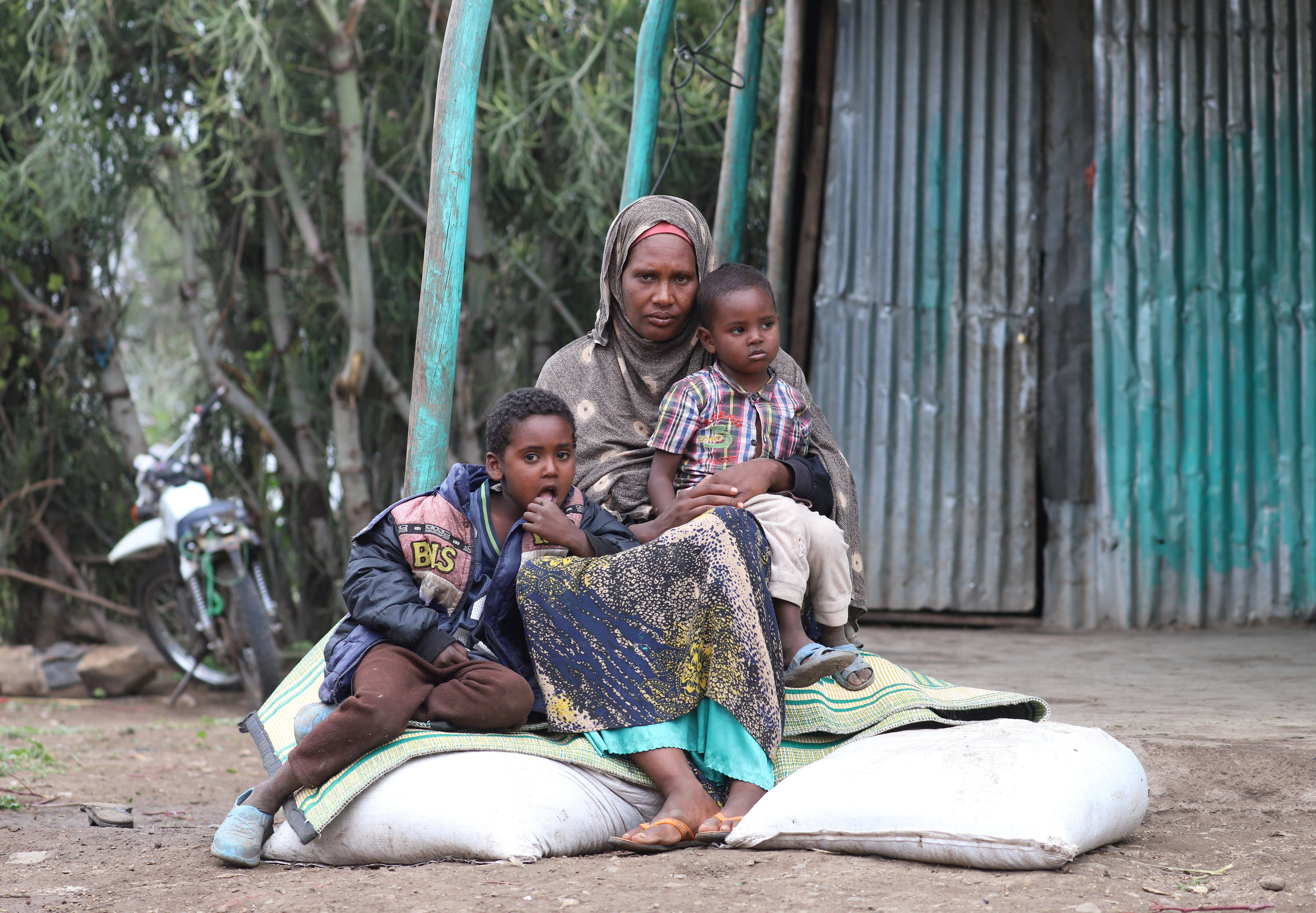 Asha Khalif Ali, 35, an internally displaced Ethiopian sits on bags of rotten wheat which was ruined by heavy rain and desert locusts, Tuli Guled, Somali Region, Ethiopia January 13, 2020. Picture taken January 13, 2020. (REUTERS Photo)