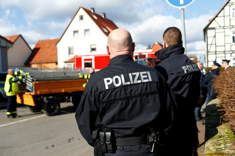 Police officers stand near the crash site one day after a car plowed into a Carnival parade, Volkmarsen, Feb. 25, 2020. (Reuters Photo)