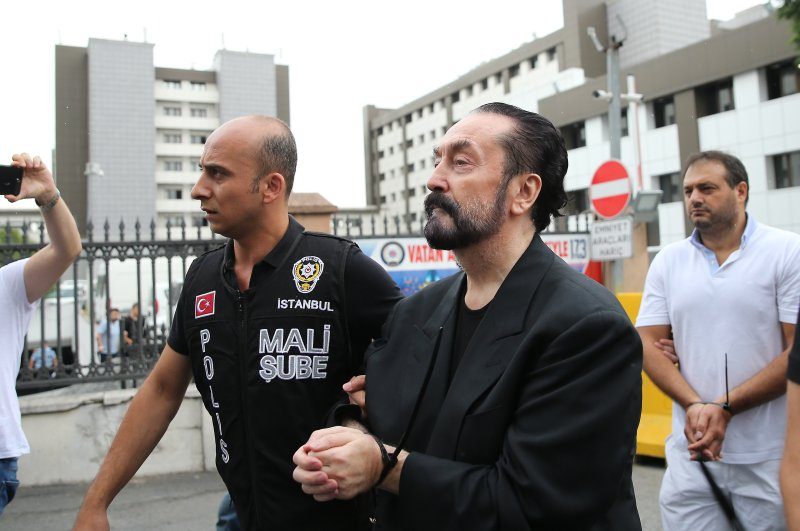 Police escort Adnan Oktar and other suspects to the courthouse, Istanbul, July 17, 2018. (AA Photo)